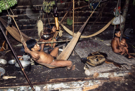 Waorani Indians,  The Nuclear Family Clusters Around Their Fire In The Longhouse, Gabado, Ecuador, 1973