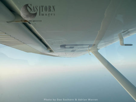A Wing Of Cessna 182 Flying